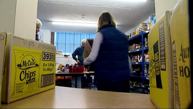foodbanks struggling to cope with sharp rise in demand; england: cheshire: macclesfield: int box of oven chips moved from shelf at food bank... - 英チェシャー州点の映像素材/bロール