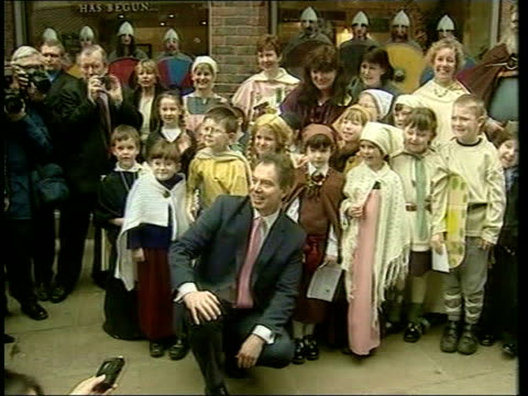 foot and mouth disease: animal movement row; itn england: devon ext tms prime minister tony blair mp posing with group of schoolchildren in mediaeval... - animal mouth stock videos & royalty-free footage