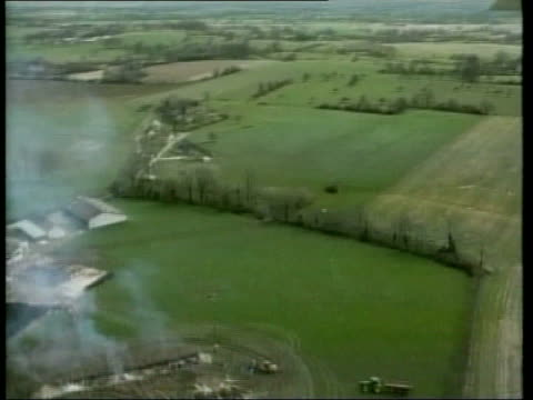 foot and mouth disease crosses channel c5f luisa mayenne views over farm where cattle are being incinerated in trench - maul und klauenseuche stock-videos und b-roll-filmmaterial