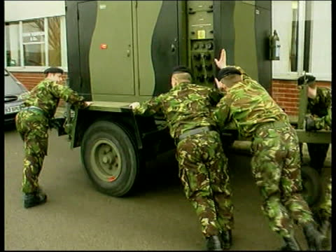 cull plans cumbria soldiers pushing trailer along pan brigadier alex birtwistle interview sot talks of material the army have assembled to build... - foot and mouth disease stock videos & royalty-free footage