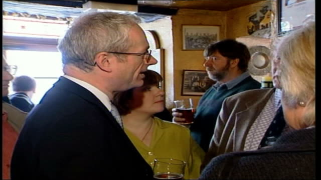 Culture Secretary Chris Smith meets local farmers ITN ENGLAND Kent Chris Smith MP drinking pint of bitter outside pub talking to bearded man INT CMS...
