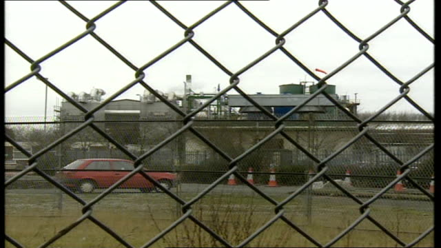 stockvideo's en b-roll-footage met incinerator buildings general views england halton ext red lorry along past camera / lorry as into incinerator compound / lorry turning in forecourt... - foot and mouth disease
