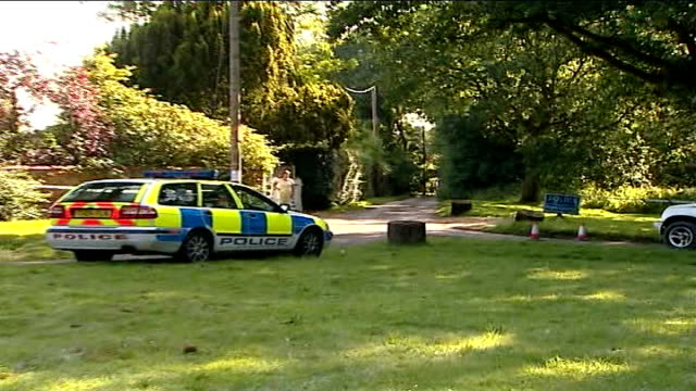 foot and mouth disease outbreak in surrey: further investigations at pirbright laboratory; surrey: sign 'the manor house' with tape cordon around... - road closed sign stock videos & royalty-free footage