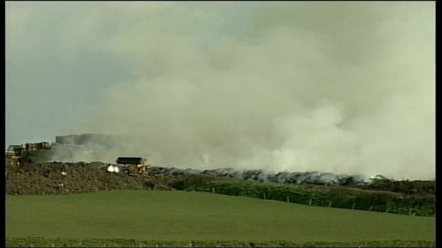 foot and mouth disease: pyres in devon; england: devon: holsworthy: ext smoke from pyre over countryside zoom to pyre / pyre burning / village of... - {{relatedsearchurl(carousel.phrase)}} video stock e b–roll