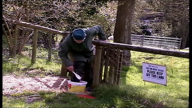 Situation improves Welsh farm ITV WEST NEWS Sign 'D' Notice Foot and Mouth Disease Please Keep Off This Land GVS Farmer disinfecting gate GVS Man...