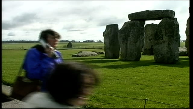 foot and mouth disease: stonehenge; itn england: wiltshire: stonehenge: ext gvs tourists walking round stonehenge, tourists taking photographs gvs... - foot and mouth disease stock videos & royalty-free footage