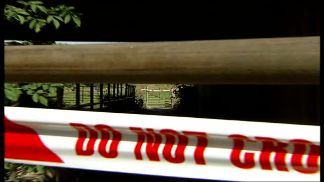 vídeos de stock e filmes b-roll de two months on interview two farmers on its effects cordon tape across farm gate pull out to another in f/g close shot and longer shot of defra 'no... - febre aftosa