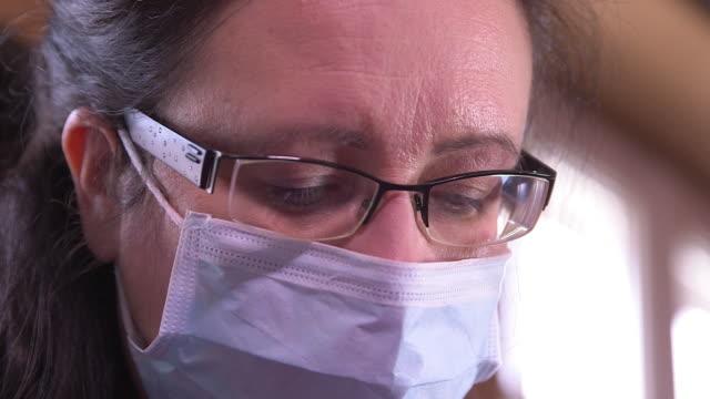 foot care, face of pedicurist in close
