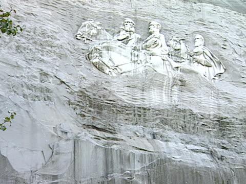 of 90 foot carving of thomas jonathan stonewall jackson, robert e. lee & jefferson davis, all on horseback, - monument stock videos & royalty-free footage