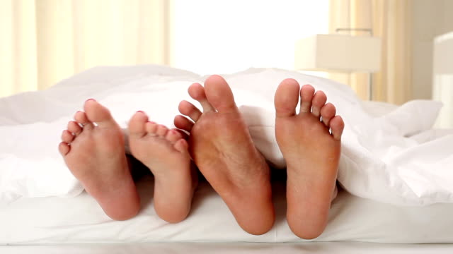 foot flirting - sexual issues stock videos & royalty-free footage