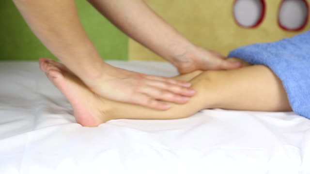 foot massage a little boy - human limb stock videos & royalty-free footage