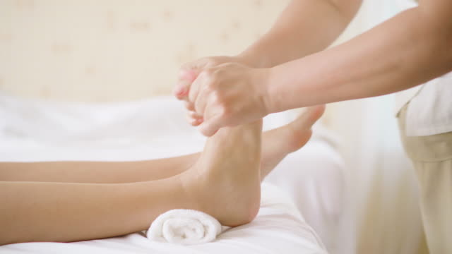 foot massage in spa salon, closeup - reflexology stock videos and b-roll footage