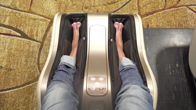 foot massage machine - human foot stock videos & royalty-free footage
