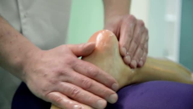 foot massage - massage therapist stock videos & royalty-free footage