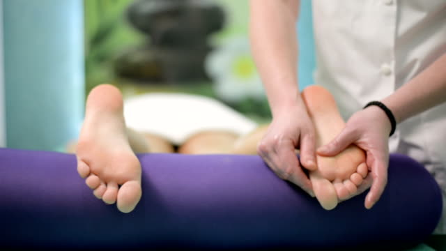 foot massage - massager stock videos and b-roll footage