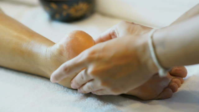 foot massage - spa treatment stock videos & royalty-free footage
