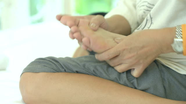 foot massage - reflexology stock videos and b-roll footage
