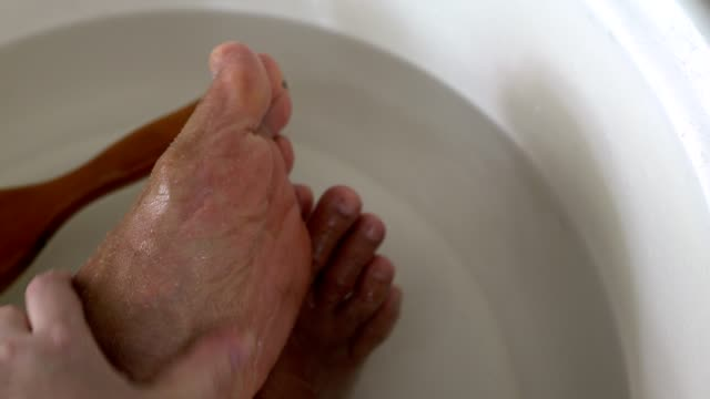 foot massage,hand massaging feet with sea salt - pedicure stock videos & royalty-free footage