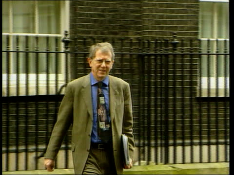 Vaccinations/Northern Ireland LIB London Downing Street EXT Professor David King towards from no10 INT CS Vaccination being prepared by gloved hand...
