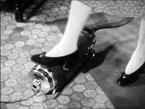b/w 1948 foot of woman turning on vacuum cleaner / industrial - hushållsapparat bildbanksvideor och videomaterial från bakom kulisserna