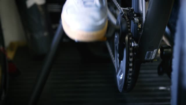 cu foot pedaling bike indoors - pedal stock videos & royalty-free footage