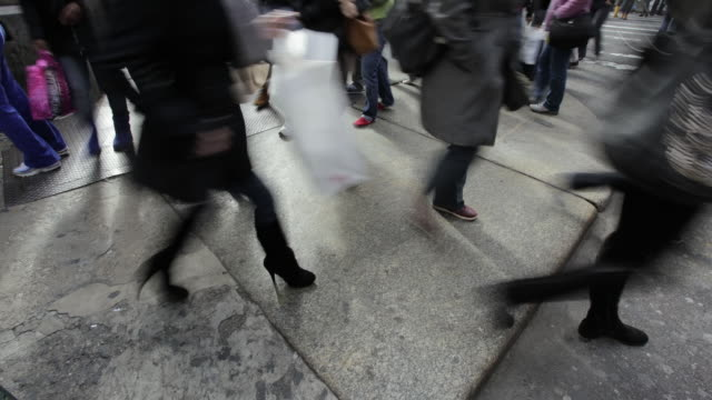 ms t/l foot traffic at busy manhattan intersection / new york, united states - human limb stock videos & royalty-free footage