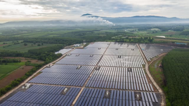footage 4k of aerial view drone hyperlapse timelapse of solar power farm panels. clean energy and environment protection - power in nature stock videos & royalty-free footage