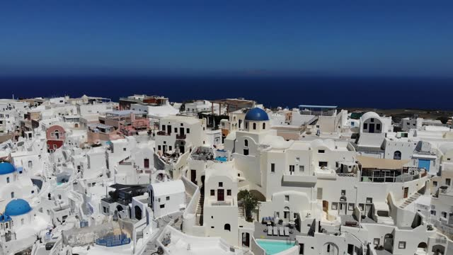 footage - aerial drone panoramic video of the world-famous picturesque traditional mediterranean village of oia in the volcanic island of santorini... - oia santorini stock videos & royalty-free footage