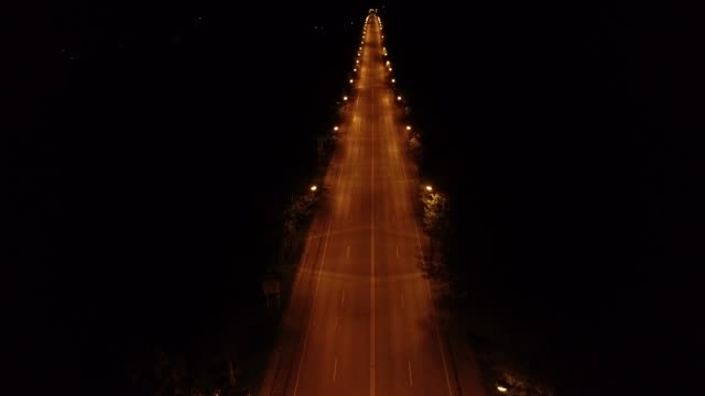 4k footage aerial shot from the high angle expressway at night - urban road stock videos & royalty-free footage