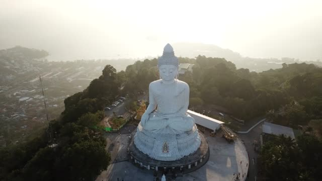 4k footage aerial view of big buddha of phuket at sunset time. - buddha stock videos & royalty-free footage