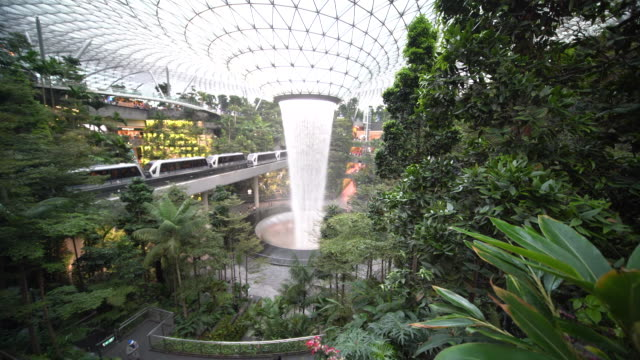 4k footage and sound colorful wide angle view of giant waterfall in jewel, changi airport, singapore - singapore stock videos & royalty-free footage