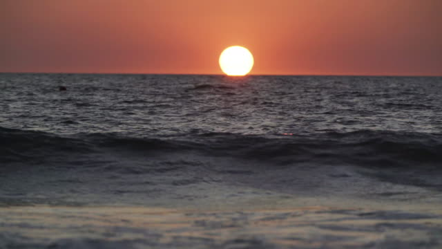 4k footage and sound real time omega sunset over the sea - omega sun mirage stock videos & royalty-free footage