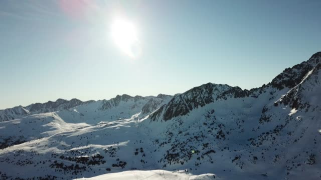 footage at the grand valira ski resort in andorra. panorama of the pyrenees mountains in the morning sun. morning soft light. winter landscape in the mountains - light blue stock videos & royalty-free footage