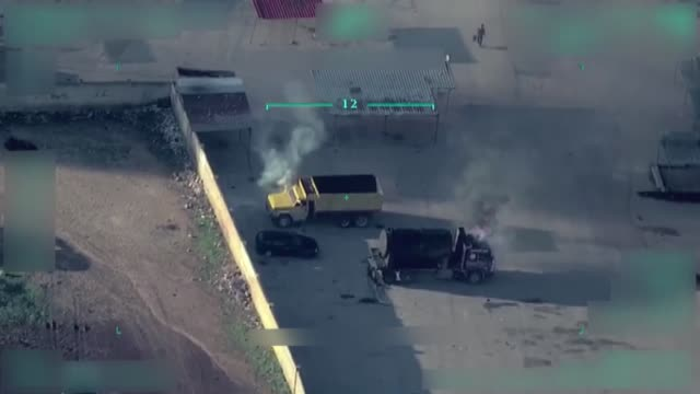 footage captured by a turkish army drone shows ypg/pkk terrorists setting vehicles on fire in afrin city center northwestern syria the video shared... - syrien stock-videos und b-roll-filmmaterial