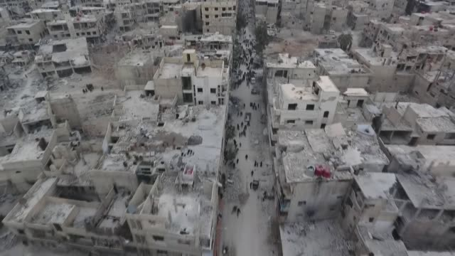 stockvideo's en b-roll-footage met footage captured by an anadolu agency drone in eastern ghouta a damascus suburb besieged by bashar alassad regime forces shows mass destruction on... - tonen