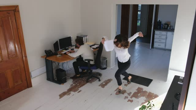 cctv footage captures a woman falling in office - blooper film clip stock videos & royalty-free footage