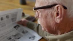 Footage Compilation of Senior Man Reading Newspaper