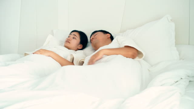 4k footage couple waking up in the morning and being stretched in the bedroom - white dress stock videos & royalty-free footage