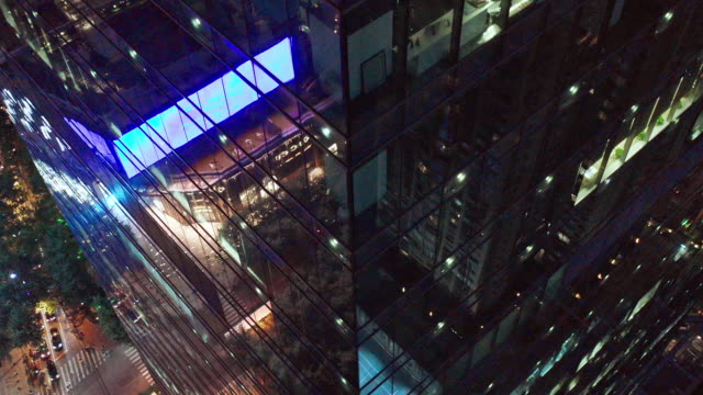 4k footage : crowded office buildings at night - smart city stock videos & royalty-free footage