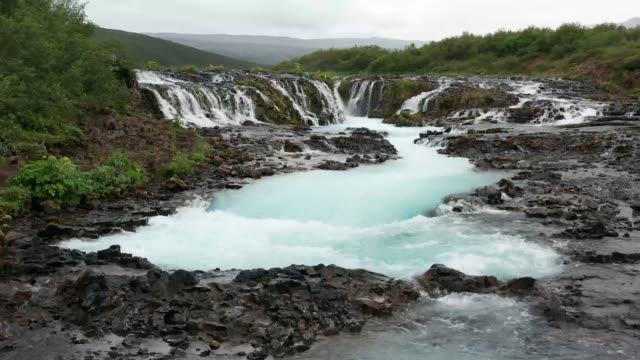 4k footage flying to bruarfoss waterfall in summer, iceland - iceland stock videos & royalty-free footage