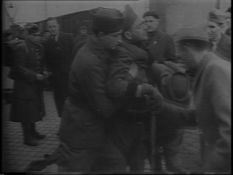 footage from 1942, french soldiers are shown dejectedly entering railway cars to be hauled off for slave labor / french pows walking towards camera /... - slavery stock videos & royalty-free footage