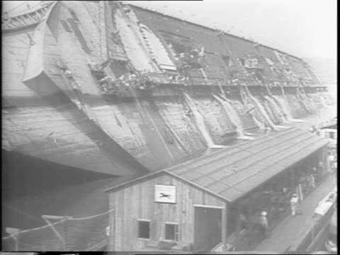 footage from 1942 sabotage of the normandie / crowds with binoculars watch the normandie from the new jersey side of the harbor / view from water of... - sabotage stock videos & royalty-free footage