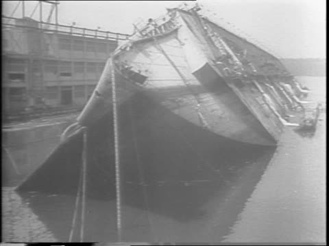 footage from 1942 sabotage of the normandie / men work to open valves of pressure pumps / man works on calculations / wheels are turning / man... - sabotage stock videos & royalty-free footage