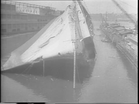 footage from 1942 sabotage of the normandie / view of the normandie on small boat behind cameramen / newsreel cameramen on pier / stop-motion footage... - sabotage stock videos & royalty-free footage