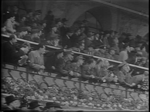 stockvideo's en b-roll-footage met footage from 1942 shots from car of paris streets during nazi occupation / building with nazi flag hanging from it / german soldiers walking down... - militaire invasie