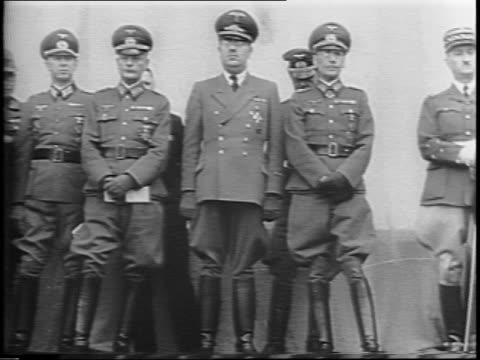 footage from 1942 wideshot of hall decked in nazi flags / closeup on side of main stage / sideview down row of german officers with flags / french... - drittes reich stock-videos und b-roll-filmmaterial