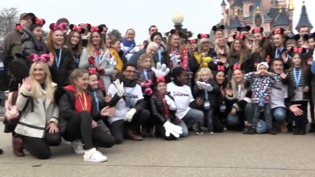 Footage from a charity flight to Disneyland Paris for families affected by the Manchester bombing which was also attended by celebrities John Bishop...