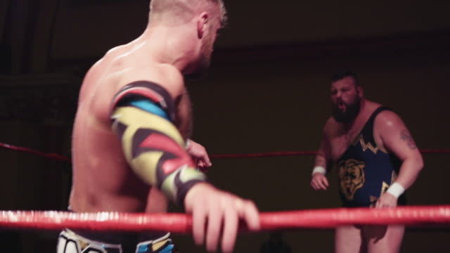 footage from an american style professional wrestling contest taking place in a small venue for an independent show 2 pro wrestlers exchanging... - masculinity stock videos & royalty-free footage