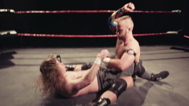 footage from an american style professional wrestling contest taking place in a small venue for an independent show pro wrestler lifts opponent high... - masculinity stock videos & royalty-free footage