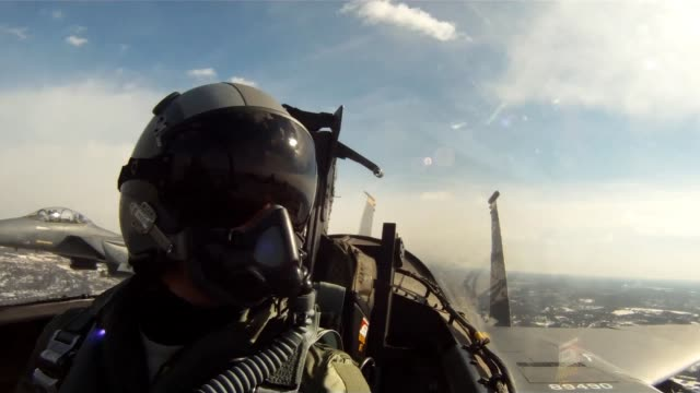 Footage from F15 cockpit during fly over Pentagon for Brigadier General Robinson Risner